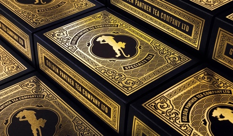 Golden Panther gift boxes. Depicts the gold-foiled box art comprised of a panther silhouette with art deco trim