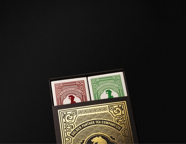 Golden Panther gift box with individual tea boxes protruding from the top opening